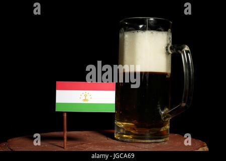 Tajikistan flag with beer mug isolated on black background - Stock Photo