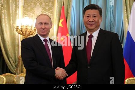 Russian President Vladimir Putin welcomes Chinese President Xi Jinping prior to bilateral talks in the Kremlin July - Stock Photo