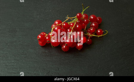 Red currants on a slate background - Stock Photo