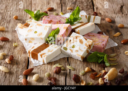 French fresh nougat with nuts and pumpkin seeds close-up on the table. horizontal - Stock Photo