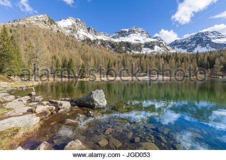 Europe, Italy, Trentino Alto Adige, Moena, Dolomites, the  alpine lake of San Pellegrino surrounded by a forest - Stock Photo