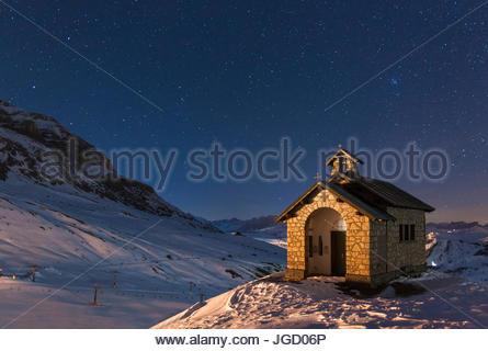 Europe, Italy, Dolomites. The alpine church at Pordoi pass at night - Stock Photo