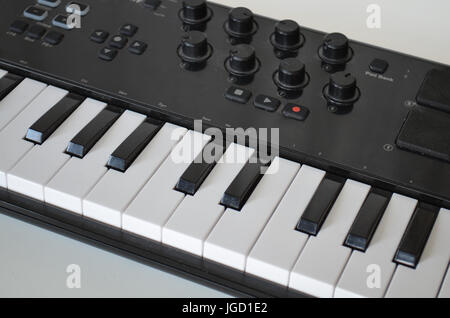Piano or electone midi keyboard, electronic musical synthesizer - Stock Photo