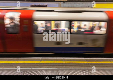 Tube train leaving the station, Underground, Piccadilly Circus, London, England, UK - Stock Photo