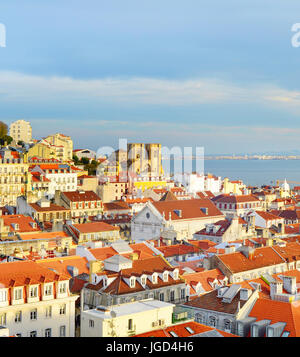 View of Lisbon Old Tow with Lisbon Cathedral  at sunset. Portugal - Stock Photo