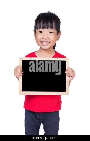 Asian little Chinese girl holding a blackboard in isolated white background - Stock Photo