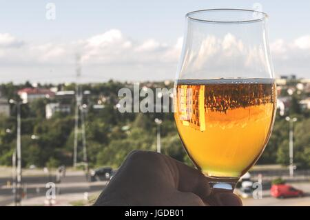 sun shines through beer in the glass - Stock Photo