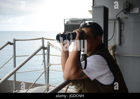 170703-N-WJ640-008 NOUMEA, New Caledonia (July 03, 2017) Sison Emerson, Able-Bodied Watchstander onboard USNS Sacagawea - Stock Photo