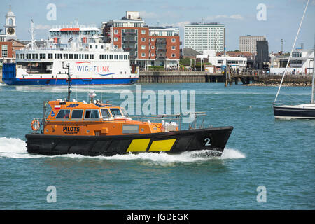 Orange and black Associated British Ports pilot boat in action in Portsmouth harbour. Nautical scene with the IOW - Stock Photo