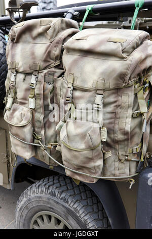 two british army special forces bergen backpacks attached to a landrover uk - Stock Photo