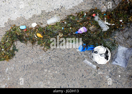 plastic waste washed up on slipway in the uk - Stock Photo