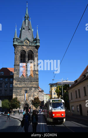 A tram passes the Jindrisska Tower in the Old Town section of Prague. - Stock Photo