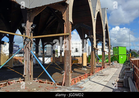 Christchurch, New Zealand - October 12, 2013:  Repairs start on the landmark Knox Presbytarian Church on the corner - Stock Photo