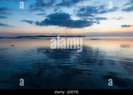 View to Gili Meno from Gili Air during sunset with volcano of Bali in the background, Lombok, Indonesia - Stock Photo