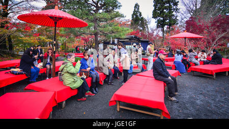 Kyoto, Japan - Nov 28, 2016. People sitting and drinking tea at Eikando Zenrin-ji Shrine in Kyoto, Japan. - Stock Photo