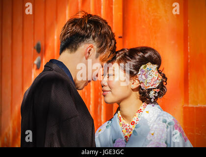 Unidentified groom and bride dress traditional costume for their wedding at Yasaka-jinja Shrine in Kyoto, Japan - Stock Photo