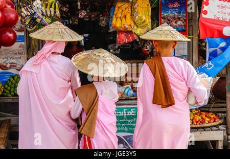 Yangon, Myanmar - Feb 21, 2016. Buddhist nuns walking for morning alms on street in Yangon, Myanmar. - Stock Photo