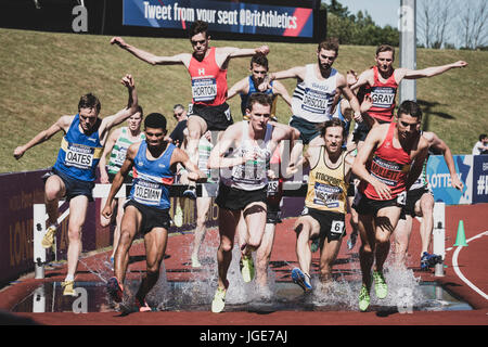 The 3000m steeplechase clears the water jump at the British Athletics Championships and World Trials at Birmingham, - Stock Photo