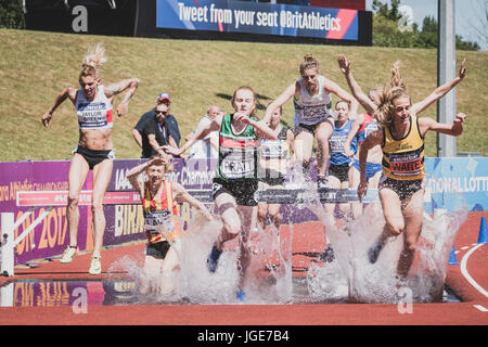 The women's steeplechase clears the water jump at the British Athletics Championships and World Trials at Birmingham, - Stock Photo