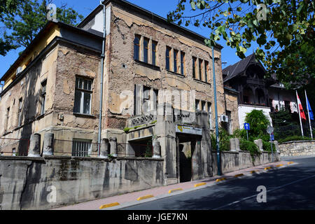 A bullet scarred building in the Old Town part of Sarajevo still shows signs of damage from the war - Stock Photo