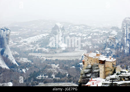 The Holy Monastery of Rousanou under heavy snow , Meteora, Kalabaka, Greece - Stock Photo