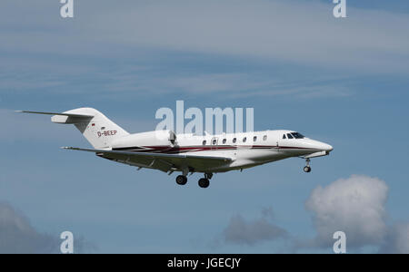 A German registered Cessna 750 Citation X on final approach to Inverness Airport in the Scottish Highlands North - Stock Photo