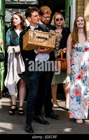Young Opera Fans Arrive At Lewes Station En Route To Glyndebourne Opera House For A Performance Of Ariadne auf Naxos, - Stock Photo