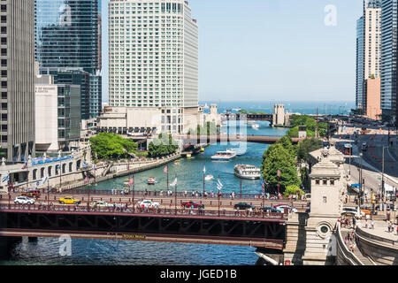 Chicago, USA - May 30, 2016: View of Wacker Drive with bridges, skyscrapers, people and cars in downtown - Stock Photo