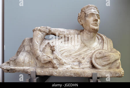 Alabaster lid a cinerary urn with a figure of a reclining man. Etruscan, 200-100 BC. Volterra, Italy. British Museum. - Stock Photo