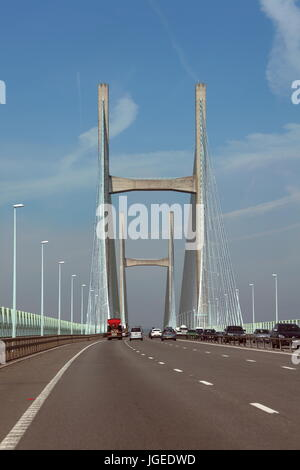 Crossing the Severn river on the new suspension bridge on the M4 road crossing on a clear sunny day with light traffic. - Stock Photo