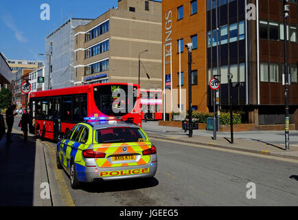 Metropolitan Police responding to a real crime incident at Harrow Bus Station - Stock Photo