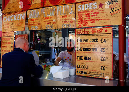 Food stalls at lunch time in Spitalfields Market in London's East End - Stock Photo