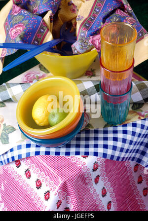 Colourful plastic beakers and bowls ready for picnic - Stock Photo