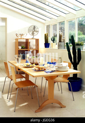 Charmant Pale Wood Furniture And Cacti In Conservatory Used As Diningroom   Stock  Photo