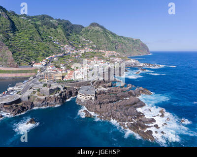 Aerial views of Madeira island small town of Porto Moniz with natural swimming pools among volcanic rocks, houses - Stock Photo