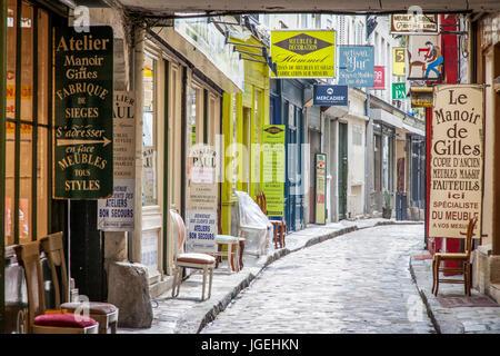 View down Passage du Chantier - known for it's furniture shops, near Faubourg Saint Antoine, Paris, France - Stock Photo