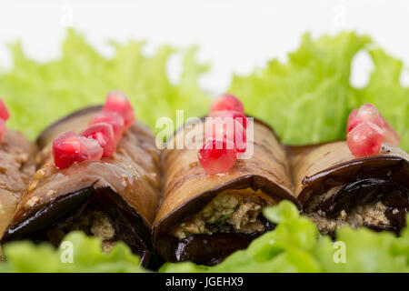 Georgian eggplant rolls with soft cheese and pomegranate seeds. Macro. Photo can be used as a whole background. - Stock Photo