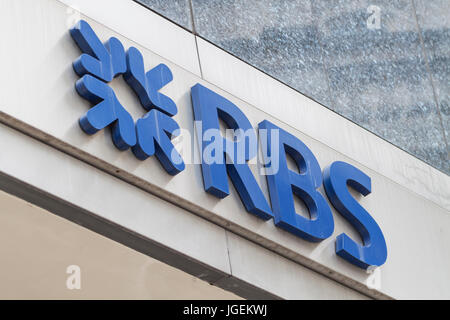 Close-up view of the Royal Bank of Scotland (RBS) brand name with logo in London - Stock Photo