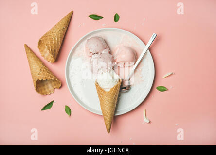 Flatlay of pastel pink strawberry and coconut ice cream scoops - Stock Photo