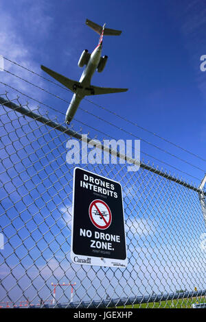 Montreal,Canada,6 July,2017.Sign indicating a no drone zone around the perimeter of Trudeau International airport.Credit:Mario - Stock Photo