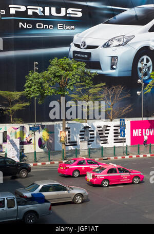 Toyota poster on hoarding above main road and traffic. Bangkok, Thailand - Stock Photo