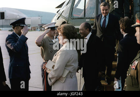 President and Mrs. Anwar Sadat of Egypt, escorted by Vice President Walter Mondale, arrive at the air terminal prior - Stock Photo