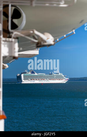 Port of Southampton looking down the Solent at the cruise ship Azura, photographed from Ventura. P&O ships. - Stock Photo