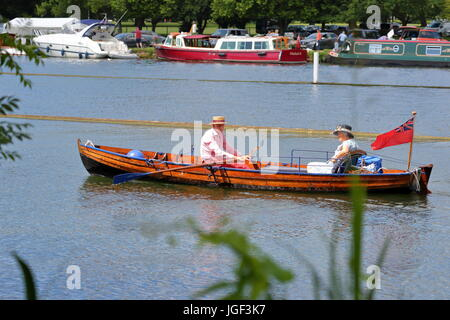 Rowers and visitors alike enjoyed the final day of Henley Royal Regatta 2017, An elderly couple rowing in a classic - Stock Photo