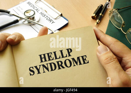 Book with title Hellp Syndrome on a table. - Stock Photo