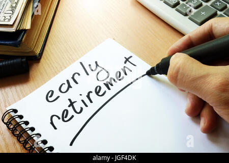 Early retirement handwritten in a note. - Stock Photo
