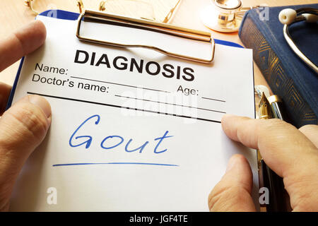 Gout written on a medical form. - Stock Photo