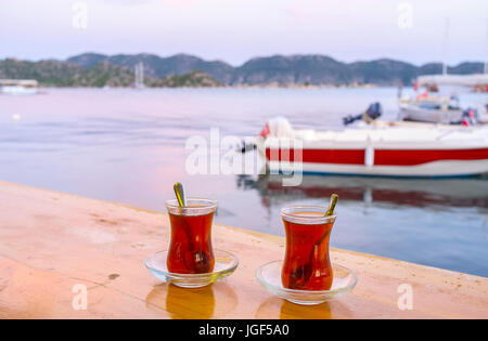 Invigorating strong turkish tea always served in traditional glasses, Kekova, Turkey - Stock Photo