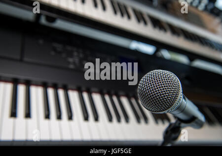 Studio room with synthesizer and microphone equipment, France - Stock Photo