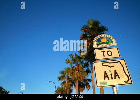 Florida Scenic Highway to A1A Sign at Sunset Beneath Palm Trees in Deerfield Beach on Hillsboro Boulevard West of - Stock Photo